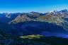 Aufstiegsweg über Wiesenhänge mit Blick zurück nach Val d'Is